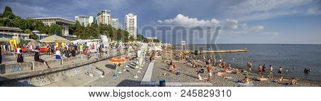 Sochi, Russia - June 16, 2018: People Sunbathe And Swim In The Black Sea