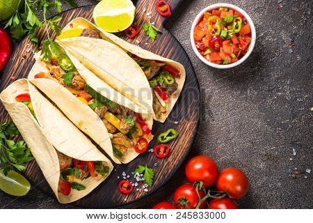 Tacos Food. Mexican Pork Tacos With Vegetables And Salsa. Traditional Latin American Food. Top View.