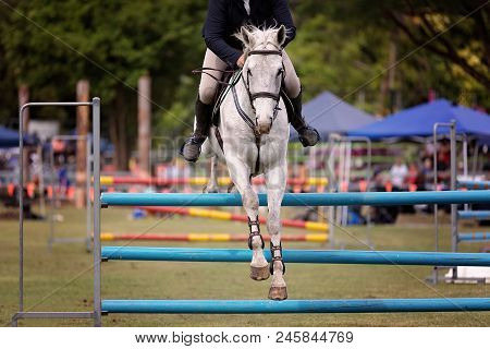 A Horse And Rider Competing In A Show Jumping Event At A Country Show