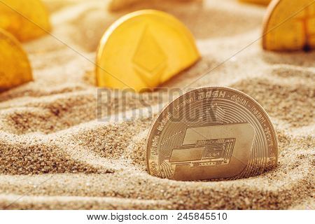 Silver Dash Coin In Sand, Conceptual Image For Lost And Found Valuable Cryptocurrency Coins That Are