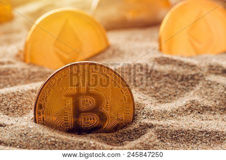Golden Bitcoin In Sand, Conceptual Image For Lost And Found Valuable Cryptocurrency Coins That Are S