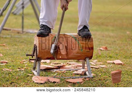 Wood Chopper Competing In An Event At A Country Show