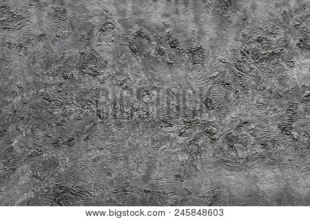 Natural detailed silver Texture. Close-up of a grey structured Background. View to a natural Wall made of Steel. Natural Textures and Backgrounds.