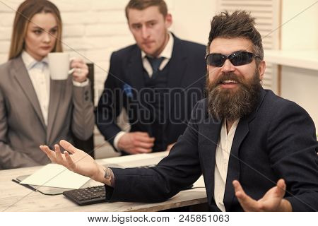 Successful Job Interview Concept. Man With Beard In Sunglasses Smiling, Bosses, Coworkers, Colleague
