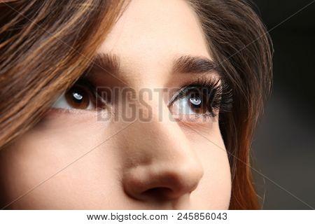 Young woman with elegant makeup and long eyelashes, closeup. Eyelash extensions
