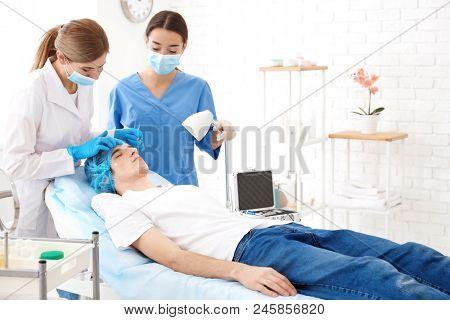 Professional beautician teaching trainee in salon. Apprenticeship concept