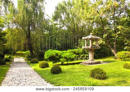 Ancient pavilion and paving road in ornamental garden, Kesson, North Korea (DPRK)
