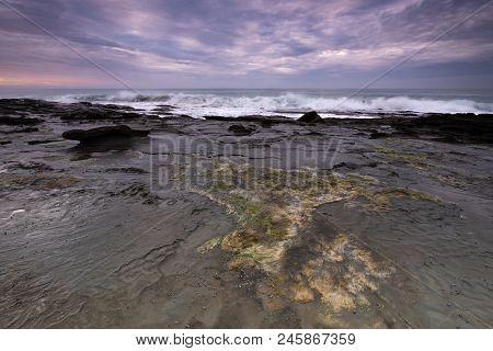 Coastline Rock Shelf Alongside The Iconic Great Ocean Road In Australia At Sunrise