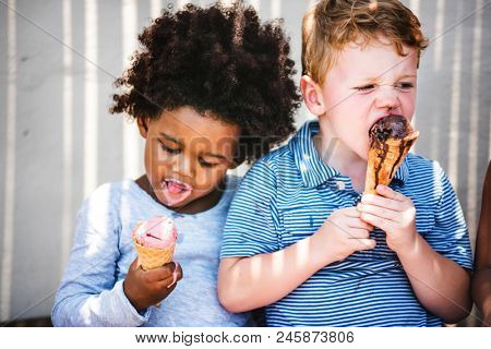 Little kids eating yummy ice cream poster