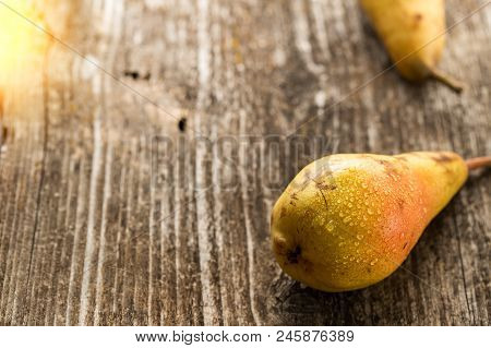 Ripe And Sweet Pears On Wooden Table. Fruit Background. Fresh Organic Pears On Old Wood. Pear Autumn