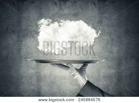 Hand Of Waitress Presenting Cloud On Tray.