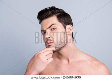 Close Up Photo Of Young Attractive Man Expertising His Face, Holding Hand On Chin With Thoughtful Ex