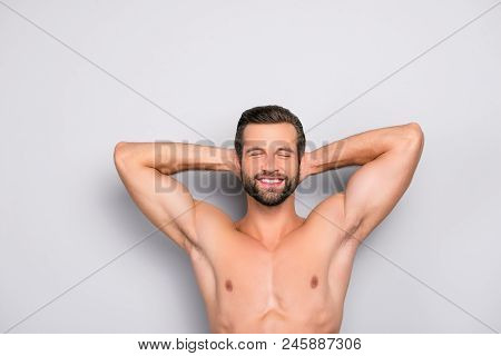Attractive, Stunning, Manly, Smiling Macho Isolated On Gray Background, Having Two Arms Behind The H