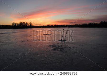 Winter Lake Fishing For Pike, Sunset, Tackle