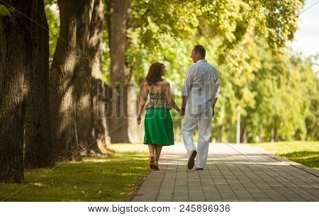 Man And Woman On A Walk In The City Park, Family Happiness, Love, Tenderness, Lived Together Years