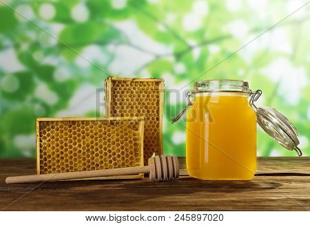 Jar Of Fresh May Honey, Bee Honeycombs And Spindle, On Wooden Table