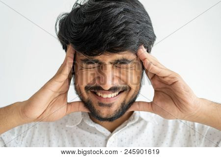 Nervous Emotional Indian Man Touching Head With Hands While Feeling Migraine. Annoyed Young Guy Gnas