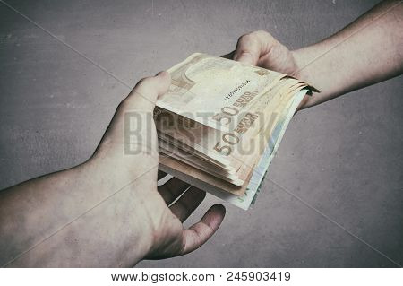 Money Loan. Bank Officer Loaning Stack Of Euro Banknotes Money,  Loan, Bribery And Corruption Concep