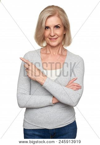 Old Woman Smiling And Pointing Finger