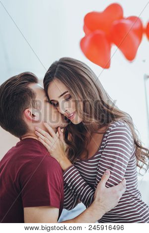 True Feelings. Pleasant Young Man Kissing His Girlfriend While Expressing His Feelings