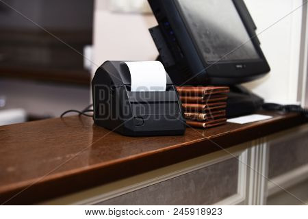 Electronic Finance And Shopping Concept. Sensor Monitor And Bill Machine Near Stack Of Restaurant Me