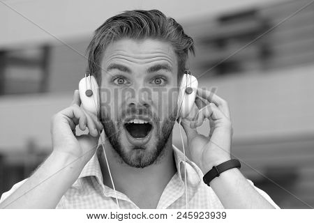 Music And Sound Concept. Man With Unshaven Face Enjoy Sound With Modern Headphones. Macho With Surpr