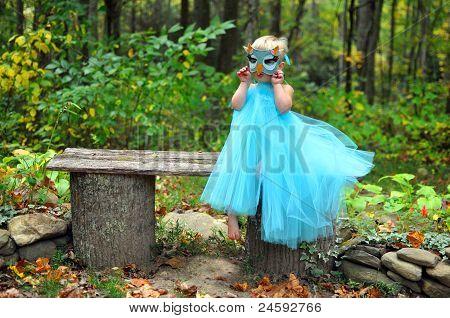 little girl in an owl costume