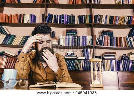 Teacher Or Student With Beard Studying In Library. Man On Yawning Face Reading Book, Studying, Books