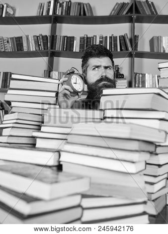 Time Stop Concept. Teacher Or Student With Beard Studying In Library. Man, Scientist Peeking Out Of