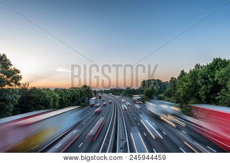 Sunset View Heavy Traffic Moving At Speed On Uk Motorway In England.