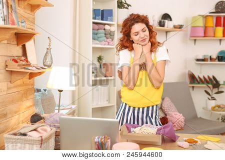 Striped Skirt. Beautiful Needlewoman With Red Wavy Hair Wearing Stylish Fashionable Striped Skirt Fe