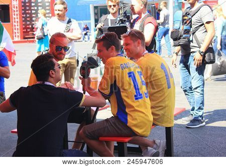 St. Petersburg, Russia - June 18, 2018: Journalist Interviewing Fans From Sweden At Fifa World Cup O