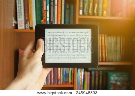 E-book In Man's Hand With Lorem Ipsum Text