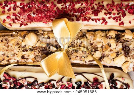 Sweet Delicious Colorful French Eclairs. Group Of French Dessert With Bow. Eclair Background. French