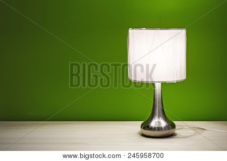 Bedside Lamp Isolated On The Table For Interior Use. Night Lamp With Round Shade Standing On A Woode