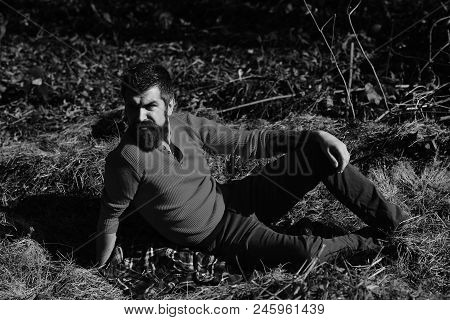 Fall Season, Loneliness And People Concept - Serious Young Man With Beard Lying On Ground Or Grass,