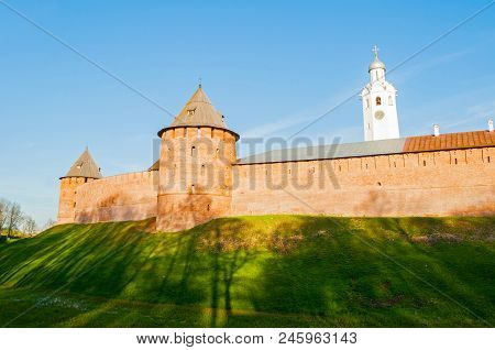 Veliky Novgorod Kremlin Metropolitan and Fedor towers with St Sophia cathedral belfry in summer evening in Veliky Novgorod, Russia poster
