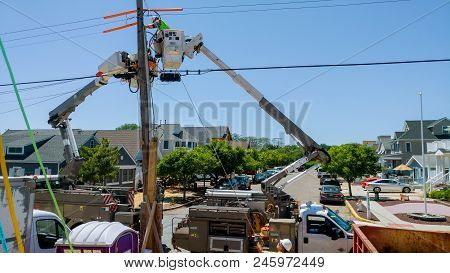 Sayreville Nj - June 15, 2018: Two Workers In Bucket Truck Doing Construction Work On Power Lines. L