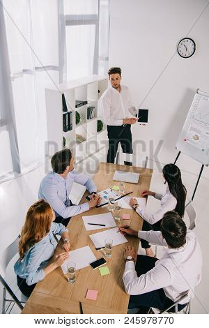 High Angle View Of Business Coworkers Having Business Training In Office
