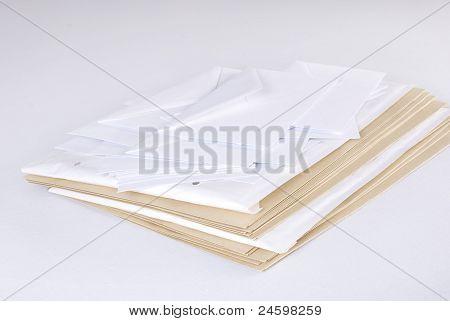 Pile Of Envelopes Over White Background.