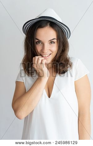Shy Positive Girl Flirting At Camera. Childish Young Caucasian Woman In White Summer Hat Touching Ch