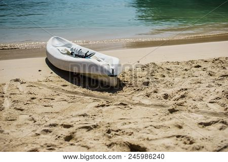 White Kayak And Paddle By The Seashore On The Beautiful White Sand Of Labadee, Haiti. No People, Qui