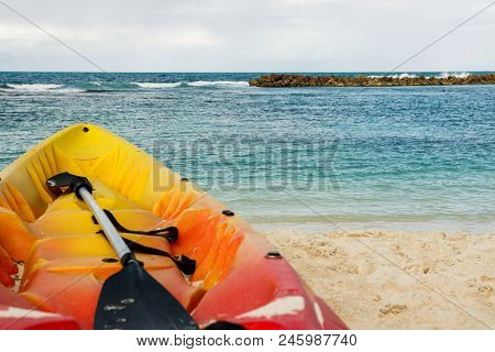 Yellow And Red Kayak And Paddle By The Seashore On The Beautiful White Sand Of Labadee, Haiti. No Pe