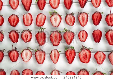 Close-up Pile Of Fresh Chopped Strawberries On White Background. Heap, Many Of Organic Ripe Sliced S