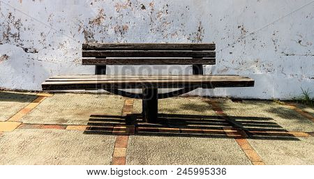 Outdoor Wooden Bench On The Streets Of Guadalupe, Caribbean Islands