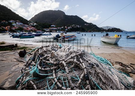 Fishing Nets On The Beach In Guadalupe, Caribbean Islands. View Of The Fishing Port Of Guadalupe.