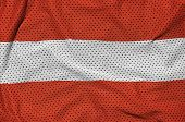 Austria flag printed on a polyester nylon sportswear mesh fabric with some folds poster