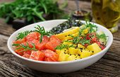 Hawaiian salmon fish poke bowl with rice, avocado, mango, tomato, sesame seeds and seaweeds. Buddha bowl. Diet food. poster