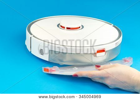 Robot Vacuum Cleaner Isolated On Blue Background. Mop Replacement .close Up Photo