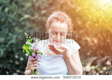 Pollen Allergy, Girl Sneezing With Bouquet Of Flowers. Concept: Seasonal Allergy.